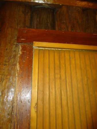 Shore Acres Lodge: partition separating cabin from managers office, broken