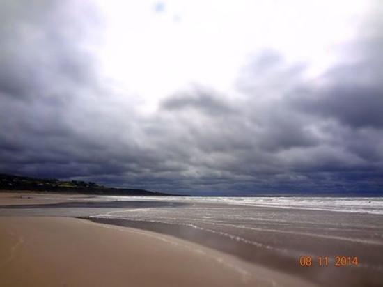 Harlech Beach: beach with dark rain clouds