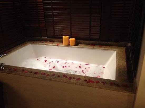 Gaya Island Resort: The massive 2 person bath in our Villas, lovingly set up with petals and scented water at Gaya I