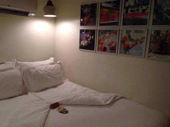 Abode Bombay : My very comfy bed with evening note