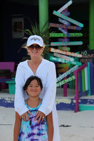 Daughter and me outside Wild Mango's on the beach
