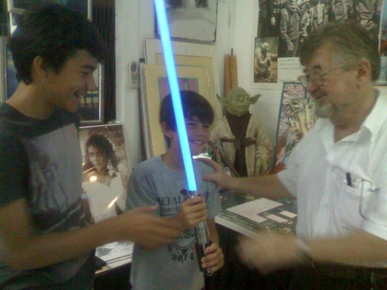 Yoda Guy Movie Exhibit : Holding Nick's light saber, notice Yoda in the background.