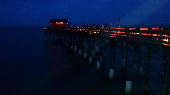 The pier at night with the tiki bar at the end picture for Cocoa beach fishing pier
