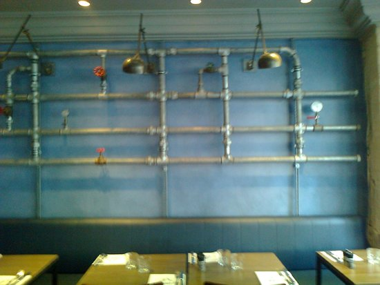 Le Robinet d'Or: Wall display in restaurant