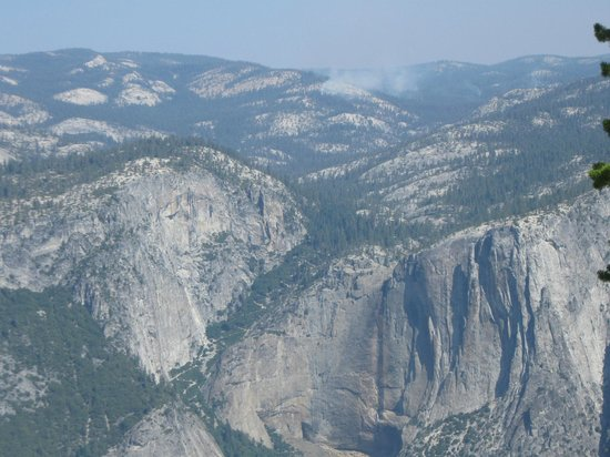 Sentinel Dome: Dry Yosemite Fall (Wall) with Dark Hole fire in distance