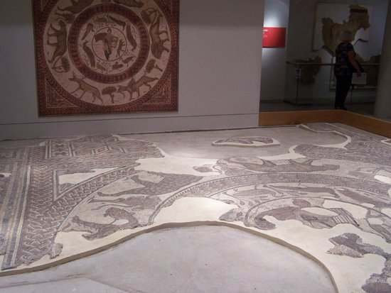 Corinium Museum: The Enchantment Mosaic, with representation of complete design on wall