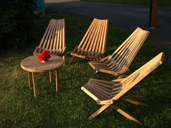 Riddle Road Retreat: Relaxing cedar deck chairs on lawn.