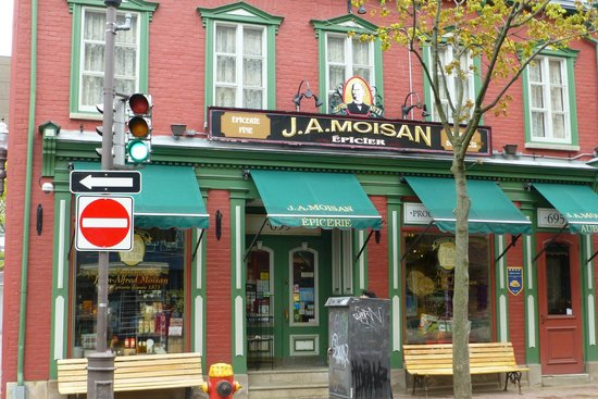J.A. Moisan Epicerie : On rue St-Jean- the front of the store