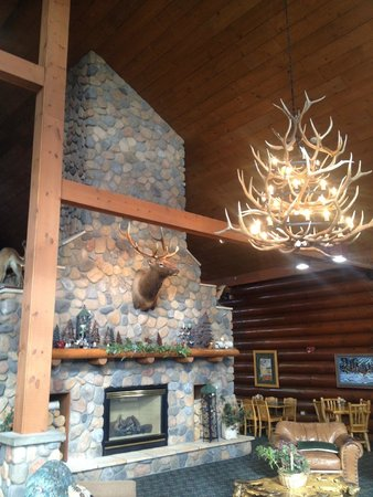 The Waters of Minocqua: Grand lobby with fireplace and hunting theme