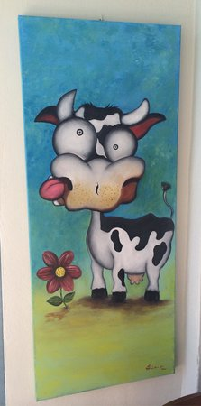 Crazy Cow Wine Bar Restaurant: Crazy Cow paintings on display:)