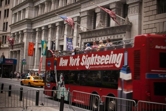 Charging Bull (Wall Street Bull): Tourist bus at the Charging Bull