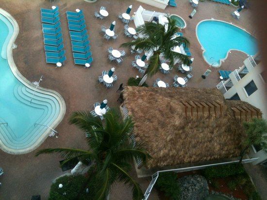 Lido Beach Resort: View of pool and tiki hut from 8th floor room