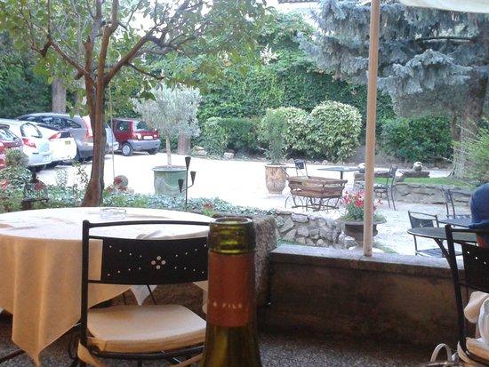 Le Manoir : terrasse - espace repas