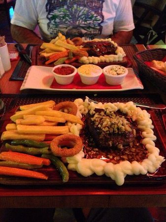 Kibele Restaurant : Steak with garlic and steak with peppercorn sauce. Both served with veg, onion rings and purée p