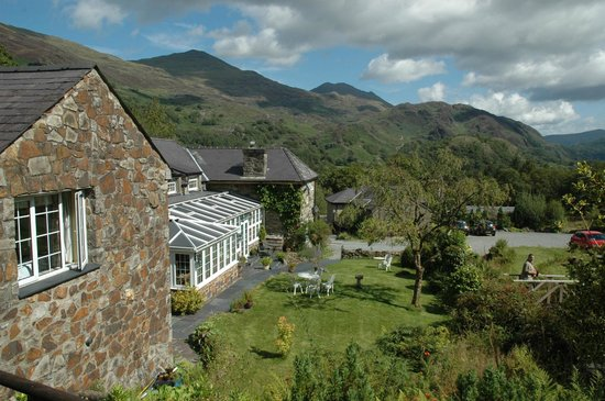 Sygun Fawr Country House: View from the gardens looking across the hotel to mountains