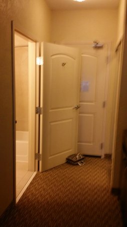 should my bathroom door open in or out. hilton garden inn abilene: had to prop the bathroom door open with my shower/ should in or out t