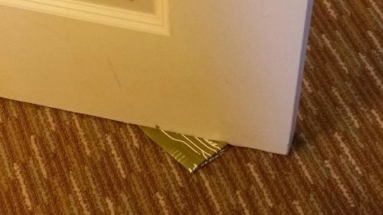 Hilton Garden Inn Abilene: ......Hilton Satisfaction Promise cards used to keep the bathroom door open