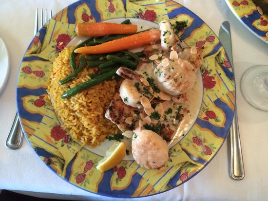 Chef Michael's: Yellowtail topped with shrimp and scallops. Yellow rice and veg.