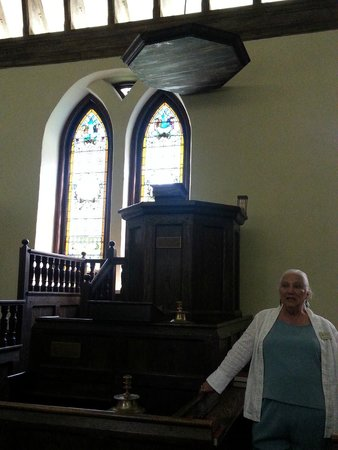 Historic St. Luke's Church: pulpit with a sounding board and our guide Mrs. LaBonne