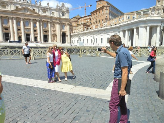 Italy Rome Tour: Max taking a photo for his group at St. Peter's Square