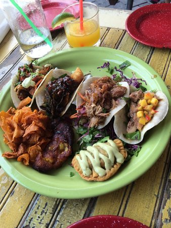 The Rum House Caribbean Taqueria: Platter of 4  tacos with Empanada patty and sweet potato chips!! What a delicious value deal !!!