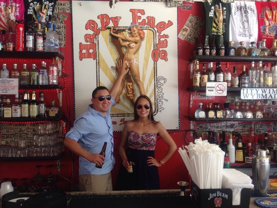 Happy Ending Cantina: Behind the bar with a sexy pinup girl poster