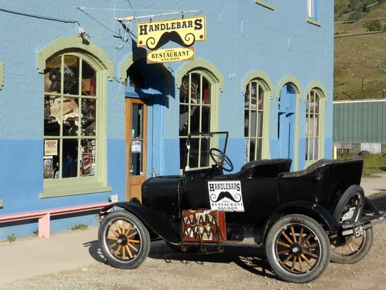 Handlebars Restaurant & Saloon: Exterior with antique car.