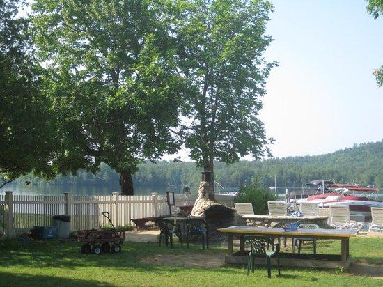 Lake Shore Motel & Cottages : fireplace, cart of firewood, view toward lake