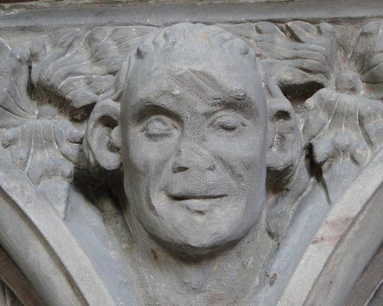 Lichfield Cathedral: Slashed head carving