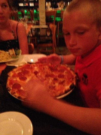 Mangia Italiano The Usual Place: My son with his salami pizza
