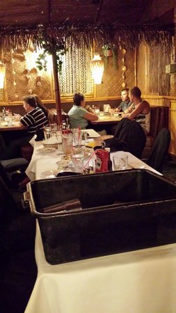 Damon's Steak House: Table not made or cleaned for almost half an hour and the dish bucket was just left there....  w