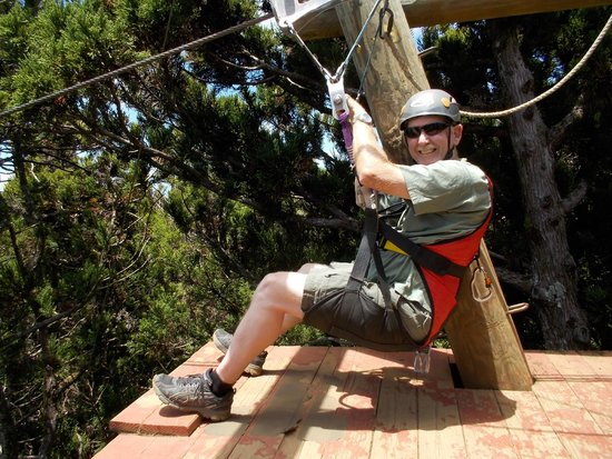 Kapalua Ziplines: My husband, see the harness he is wearing? That whole seat thing he is sitting in is the harness