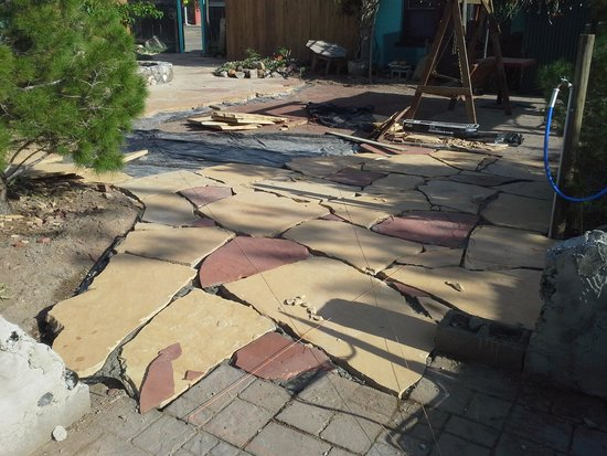 Fire Water Lodge: new flagstone in the courtyard finish by August