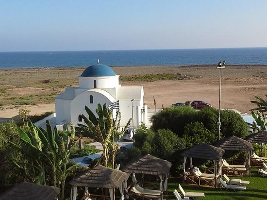 Constantinou Bros Pioneer Beach Hotel: Small Greek Church and cabanas
