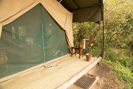 Rekero Camp, Asilia Africa: A spot to wash your hands with warm water before going into the tent..