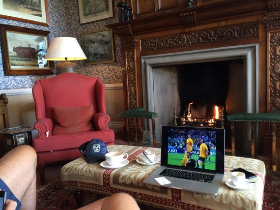 Bovey Castle Hotel: Watching the rugby by the fireplace