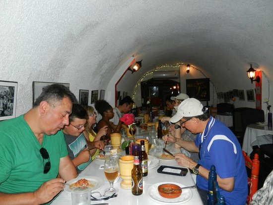 Flavors of San Juan Food and Culture Tours: Our eclectic group dining on lunch they made in the tunnel.