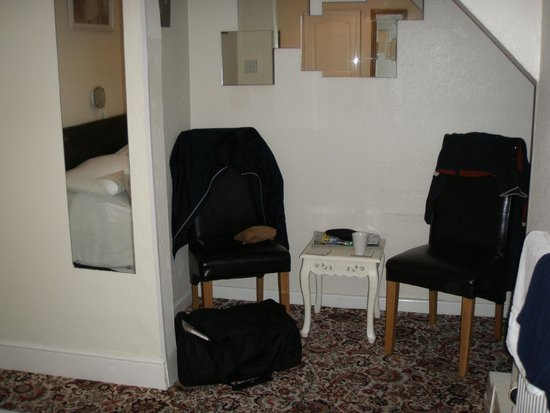 A Table and two comfortable chairs in my Double room at the Ravenswood Hotel