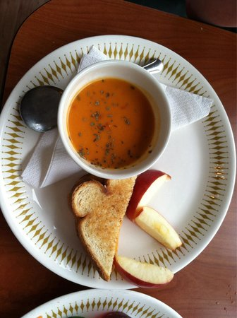 Sassy Sunflowers Bakery & Cafe : Kids grilled cheese with tomato basil soup. (Portion includes two slices if grilled cheese)