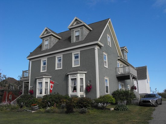 Louisbourg Heritage House Bed & Breakfast: view of b and b - our car parked next to room