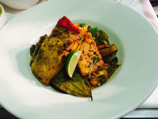 Passage to India: Salmon machli - salmon fillets marinated in chefs special spices & pan fried served with fresh m