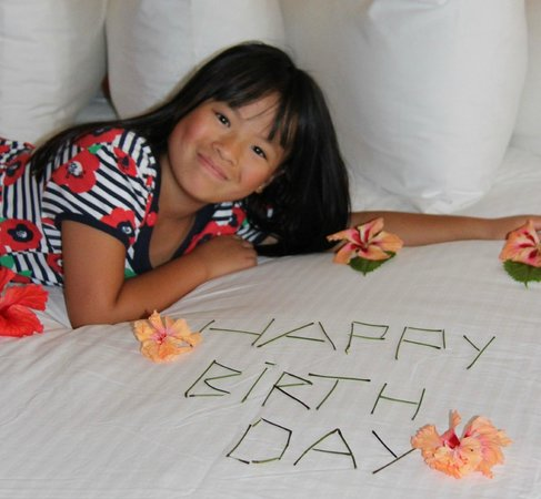 The Phoenix Resort : Daughter with Birthday surprise on bed