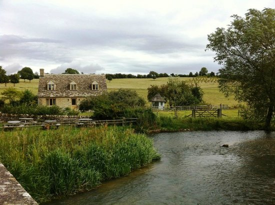The Swan Inn: A view of the Riverside Cottage from the bridge