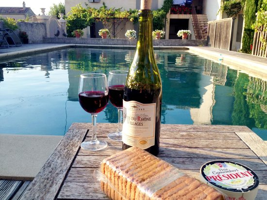 Le Mas des Tourterelles : We bought wine and cheese in town and rested by the pool after a day of sightseeing.