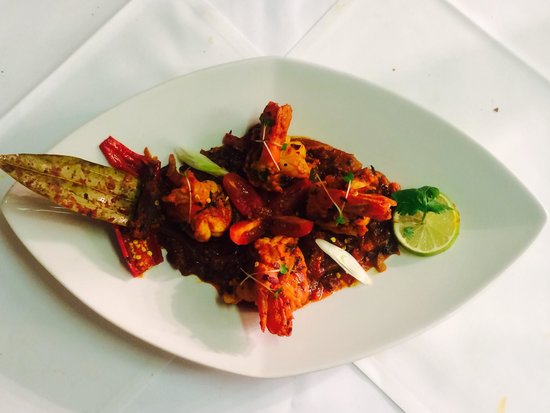 Passage to India: King prawn dynasty - jumbo king prawns cooked in onion gravy with crushed red chillies coriander