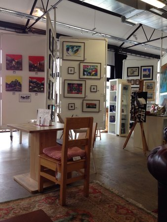 Cafe NeST: Different artists exhibiting on each board.