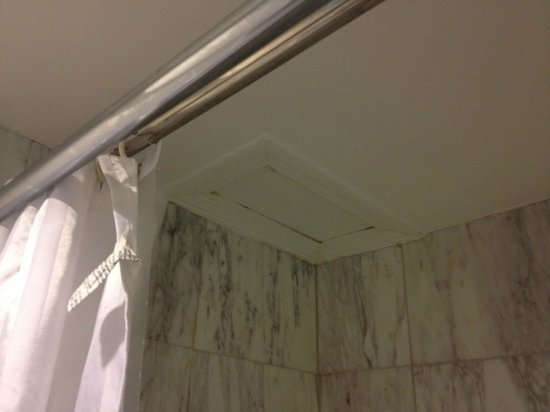 Boston Hotel Buckminster: Where could this trap door in the ceiling of the shower lead to?
