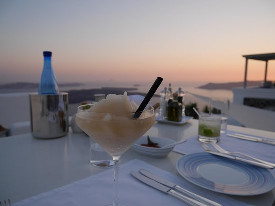Iconic Santorini, a boutique cave hotel: sunset martini at the restaurant