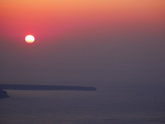Iconic Santorini, a boutique cave hotel: sunset from the church nearby