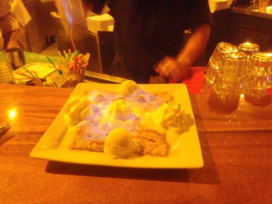 Toatea Creperie & Bar: Lit my crepe on fire! Brandy on the apples! Very strong, but I wasn't tipsy.